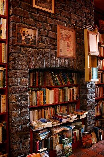 books in fireplace from a Lark bookshop via Joni V Bs photostream flickr
